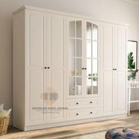 lemari pakaian minimalis 4 pintu kayu mahoni cat putih dan istimewah