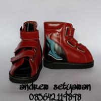 sepatu koreksi orthopedi merah