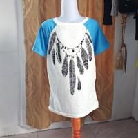 baju kaos wanita putih biru motif Merk justice LD70 panjang 49