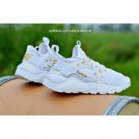 Sepatu Wanita Sport Nike Supreme - Putih Aksen Emas