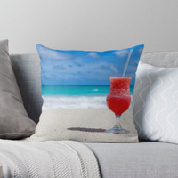 Bantal Kotak Custom Red slush drink glass on beach