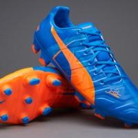 Sepatu bola Puma evopower Trick FG Blue Orange Grade Ori