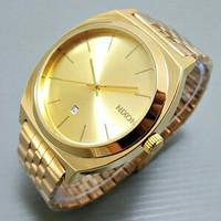 Jam Tangan Pria Cowok Nixon Classic Date Rantai Full Gold