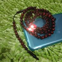 Tasbih akar bahar kristal merah tembus cahaya