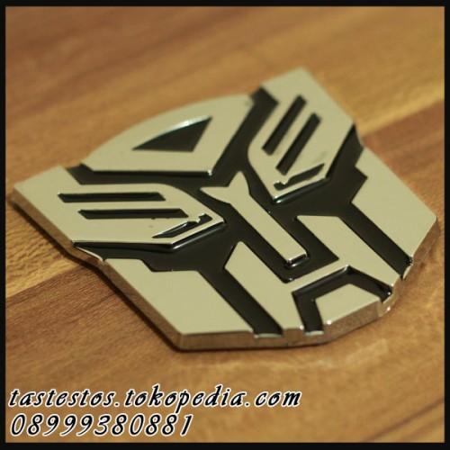 Foto Produk Emblem Transformers Stainless ( Pattern Autobots )  dari TasTesTos