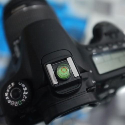 Foto Produk JJC SL-1 Hot shoe cap cover dengan bubble level support Canon dari Genesis Camera Surabaya