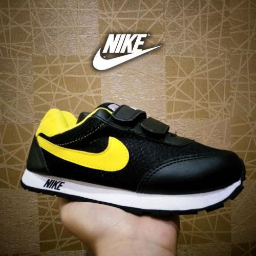 Foto Produk sepatu sport junior nike hitam kuning / sneaker anak 33 34 35 36 37 dari Potatoss