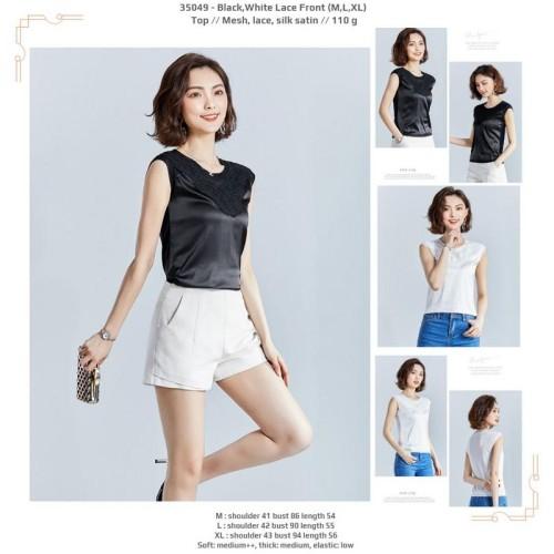 Foto Produk 35049 Lace Front Top / Blouse Hitam Putih Tanpa Lengan dari XineShop
